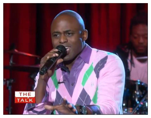 Comedian Wayne Brady wearing JED Clothing